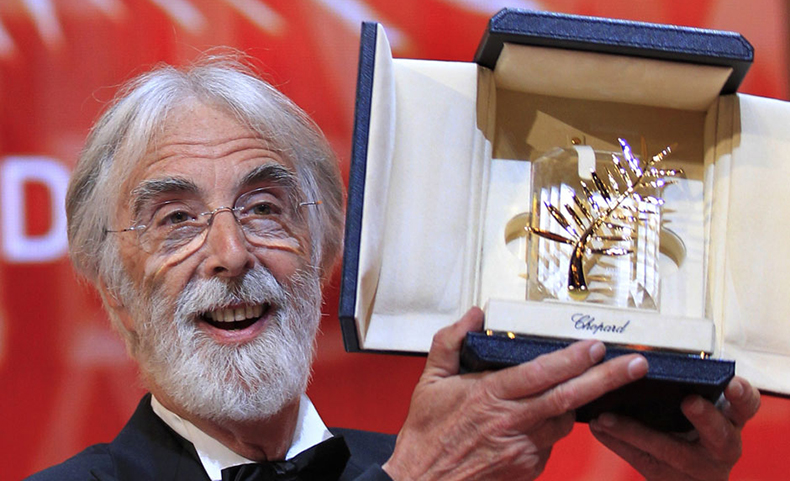 "Director Michael Haneke reacts after receiving the Palme d'Or award for the film ""Amour"" (Love) during the awards ceremony of the 65th Cannes Film Festival, May 27, 2012. REUTERS/Yves Herman (FRANCE - Tags: ENTERTAINMENT)"