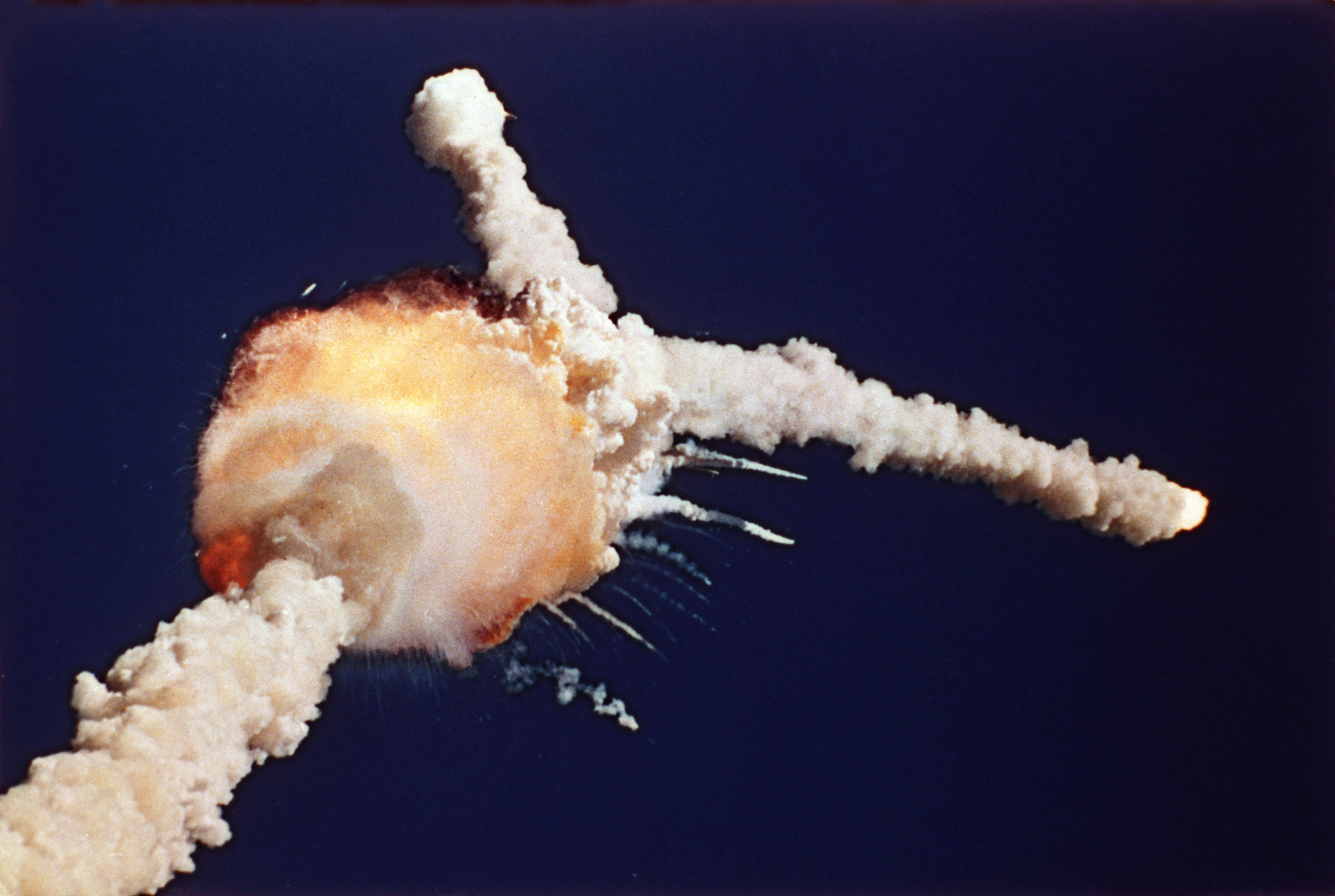 The Space Shuttle Challenger explodes shortly after lifting off from Kennedy Space Center, Fla., Tuesday, Jan. 28, 1986. All seven crew members died in the explosion, which was blamed on faulty o-rings in the shuttle's booster rockets. The Challenger's crew was honored with burials at Arlington National Cemetery. (AP Photo/Bruce Weaver)